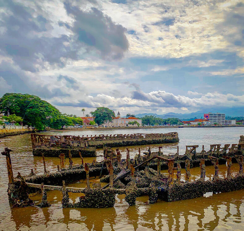Views of rusted-out ship remains in Ana Chaves Bay. As seen during AIRINC's onsite survey of São Tomé, São Tomé & Príncipe. Photo taken by AIRINC Surveyor Andrew Morollo