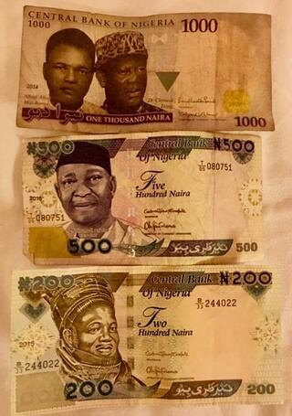 Nigeria Naira - photo of the 200, 500, and 1,000 Naira notes. Photo taken by Andrew Morollo while on-site for AIRINC's cost of living survey of Lagos, Nigeria.
