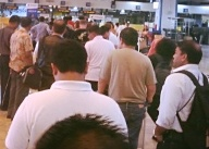 Waiting in lines in Manila's international airport for hours