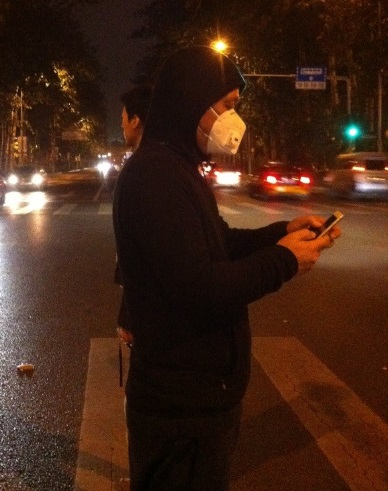 Beijing man wearing mask with filters due to air pollution