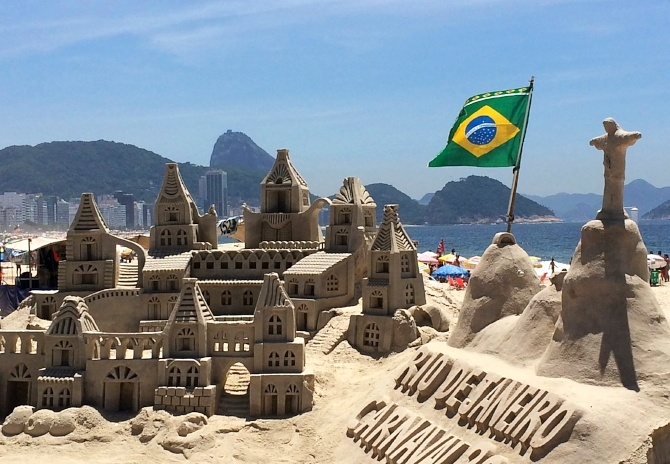 A view of Rio de Janeiro, Brazil showing the beach and an intricate sand sculpture of the city as seen by AIRINC's on-site cost of living surveyor in 2016