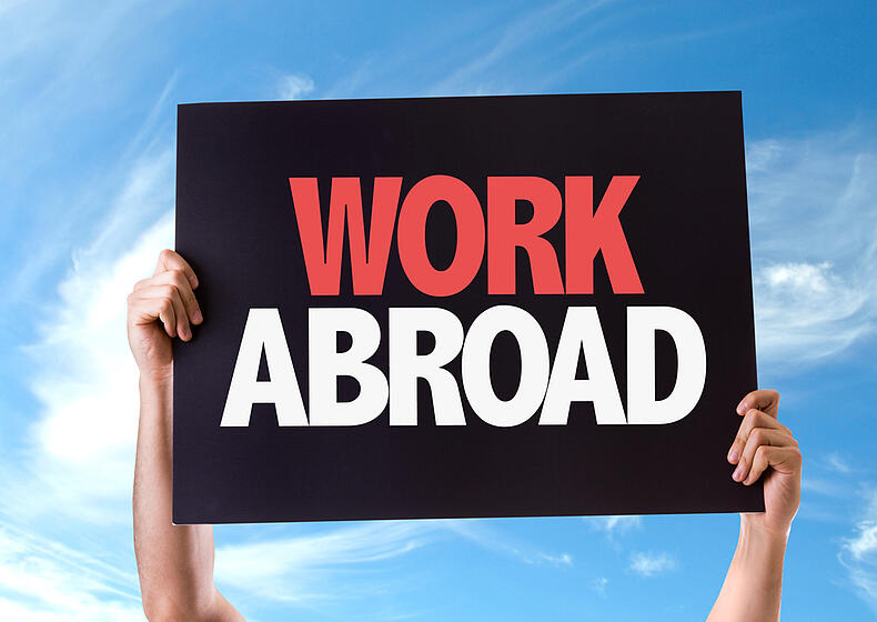 Work Abroad card with sky background