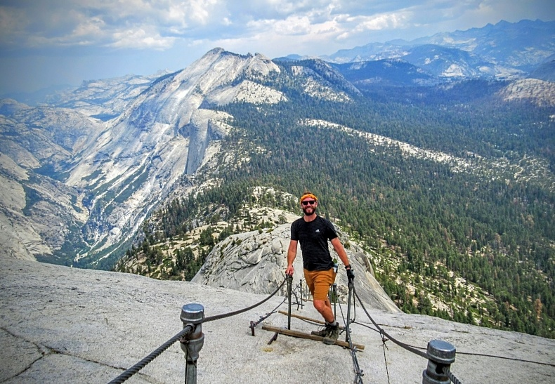 AIRINC's West Coast Director, Jordan Blue, on top of the Half Dome in Yosemite.