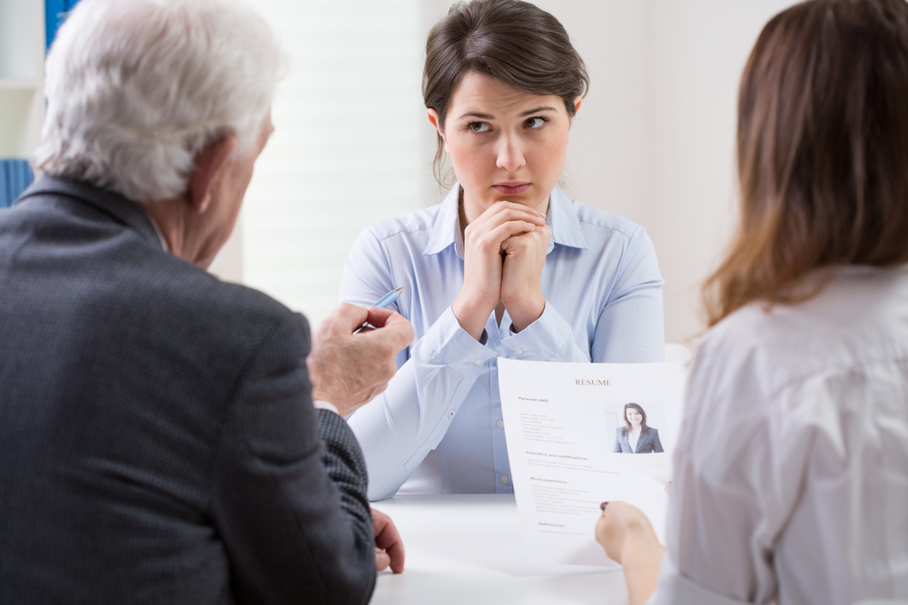 Woman during difficult job interview at a corporation